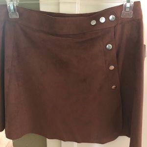 Brown suede material skirt with silver buttons